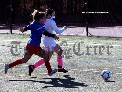 TMHS junior Daniela Almeida chases down the ball