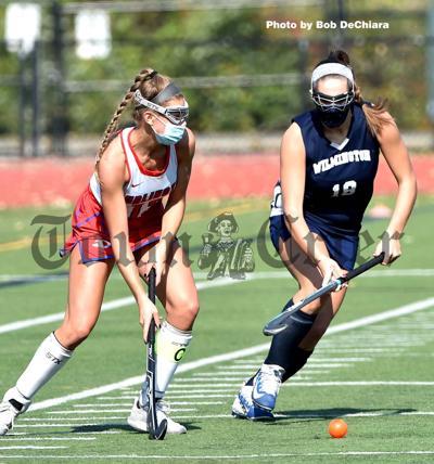 WHS' Zoe DeRose fights for a loose ball against Burlington's Jolene Russo
