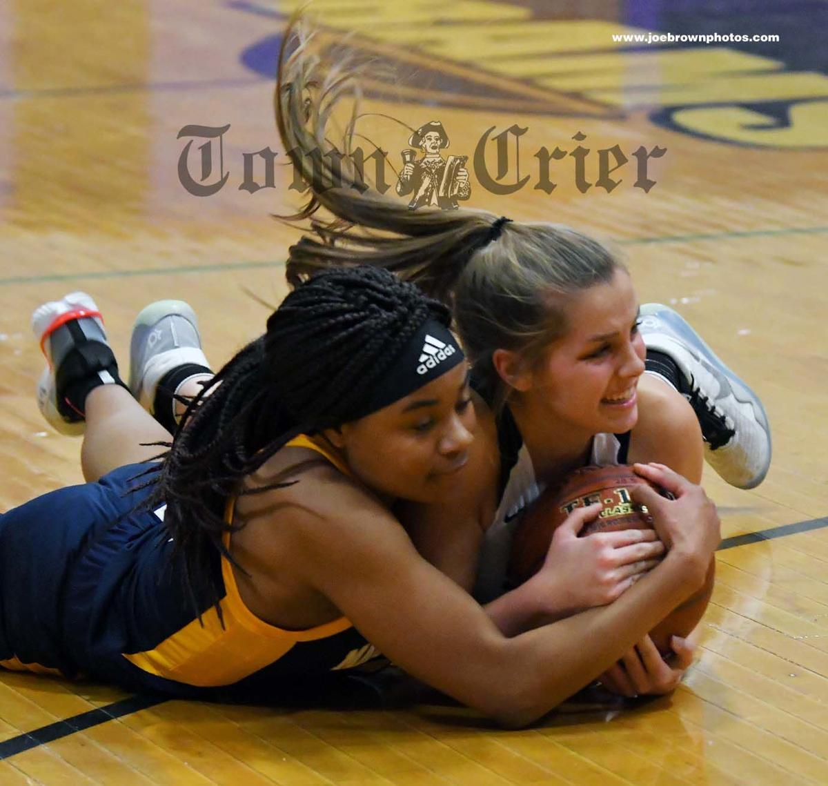 Malden Catholic's Andrea Turner, left, and Shawsheen's Shelby Bourdeau fight for the ball