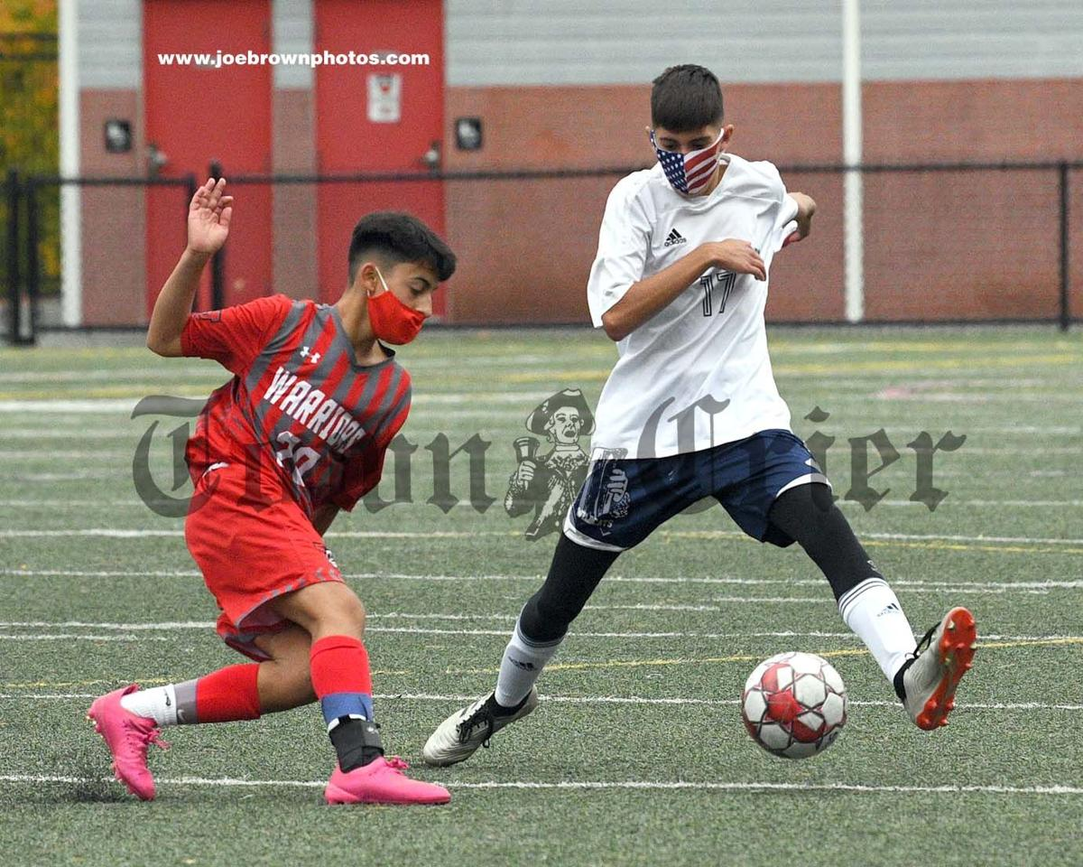 Wilmington's Evan Shackleford takes control of the ball