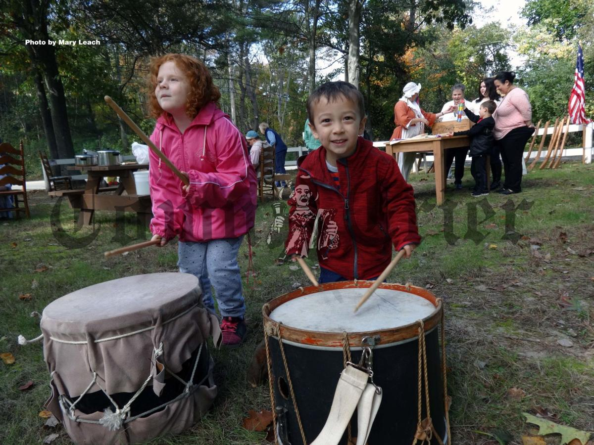 Madison Cappella, 6, and Robbie Bartolanzo, 3, beat drums