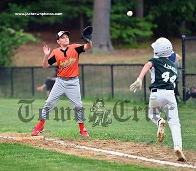 Orioles player JR Haggerty makes the out at first on Jake Banda