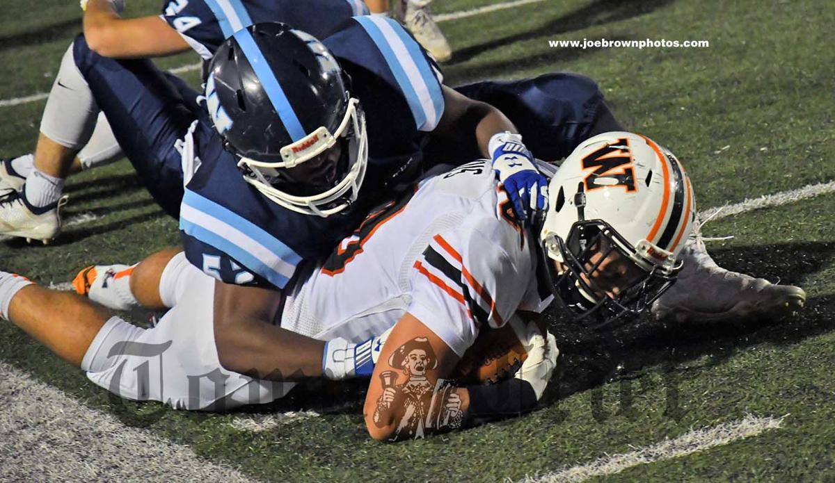 WHS sophomore Jeanty Yvenson makes a tackle
