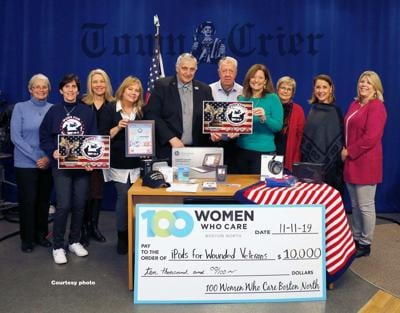 IFWV accepts check from 100 Women Who Care Boston North