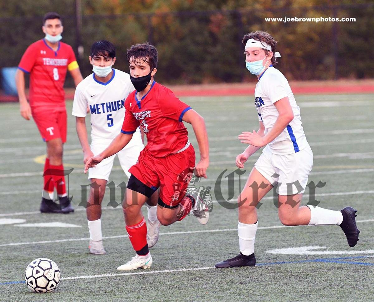 Tewksbury's Evan Mendonca chases down a loose ball