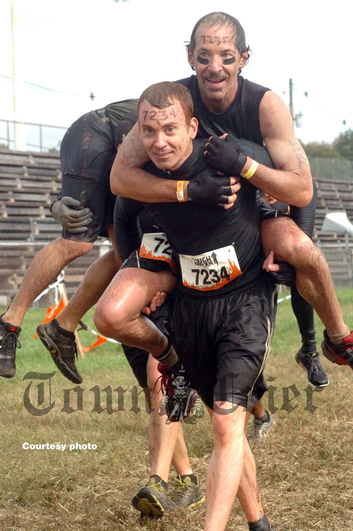 "Daniel Buckelew carries father during a ""Tough Mudder"""