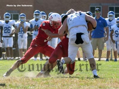 Tewksbury's Danny Fleming (No. 9) and brother Patrick combine to make tackle