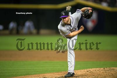 Scott Oberg throws a pitch for the Rockies