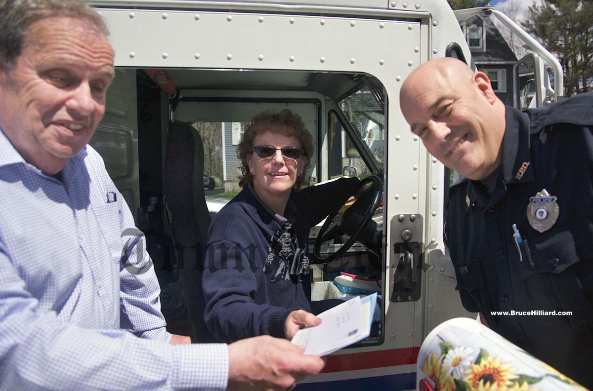 Retiring Wilmington letter carrier Denyce De Roche with a few friends