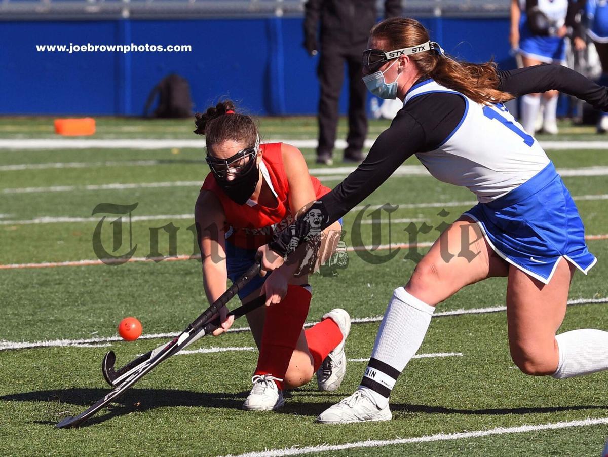 TMHS senior captain Michelle Hinkle battles for a ball
