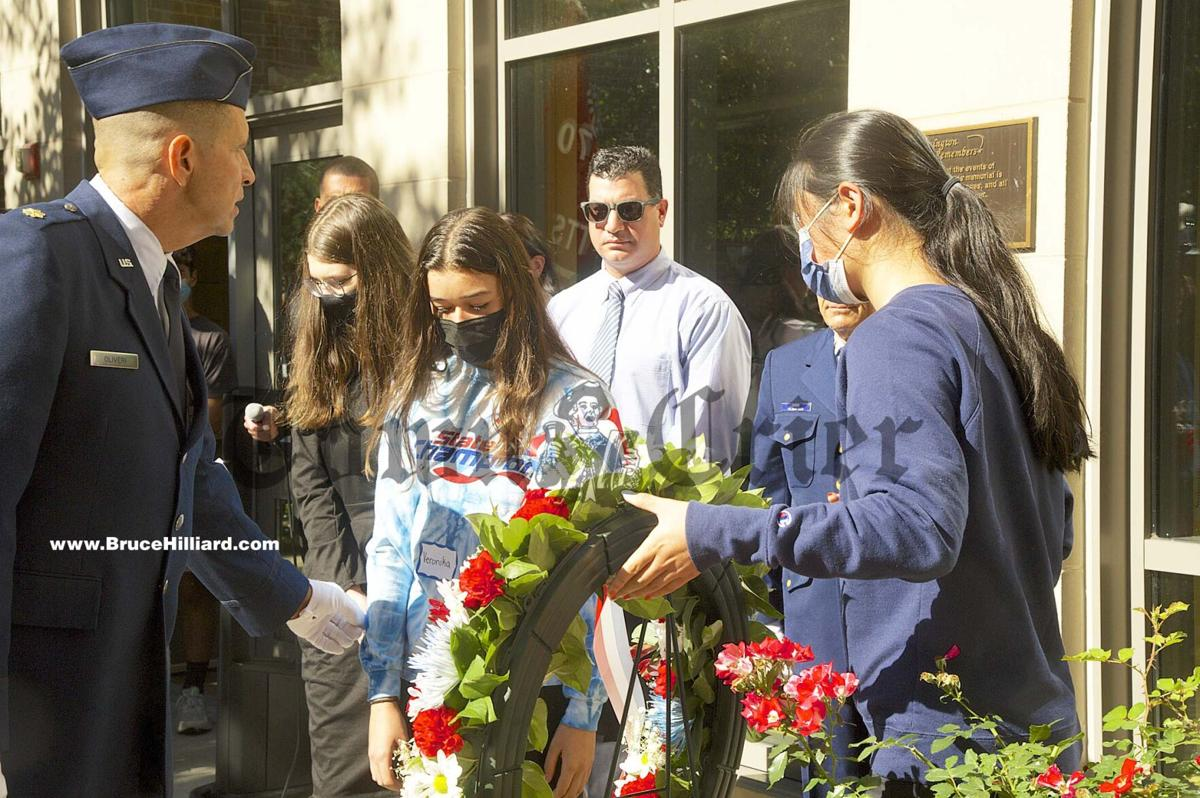 Placing a wreath on the 9-11 monument
