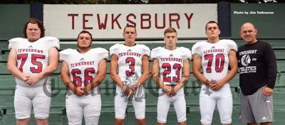 Coach Brian Aylward and the captains of the 2019 TMHS Football team