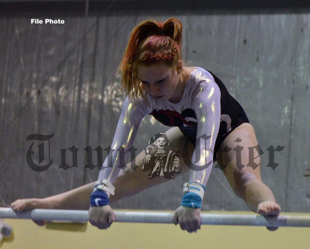 Isabelle Simone on the bars