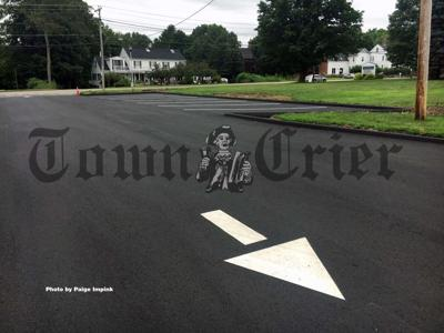 New parking spaces and striping will help improve traffic flow