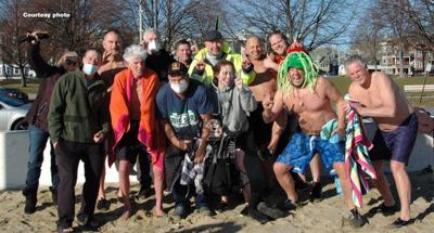 Tewksbury resident Tom Furey (with the orange towel around him) took part in the annual Polar Plunge