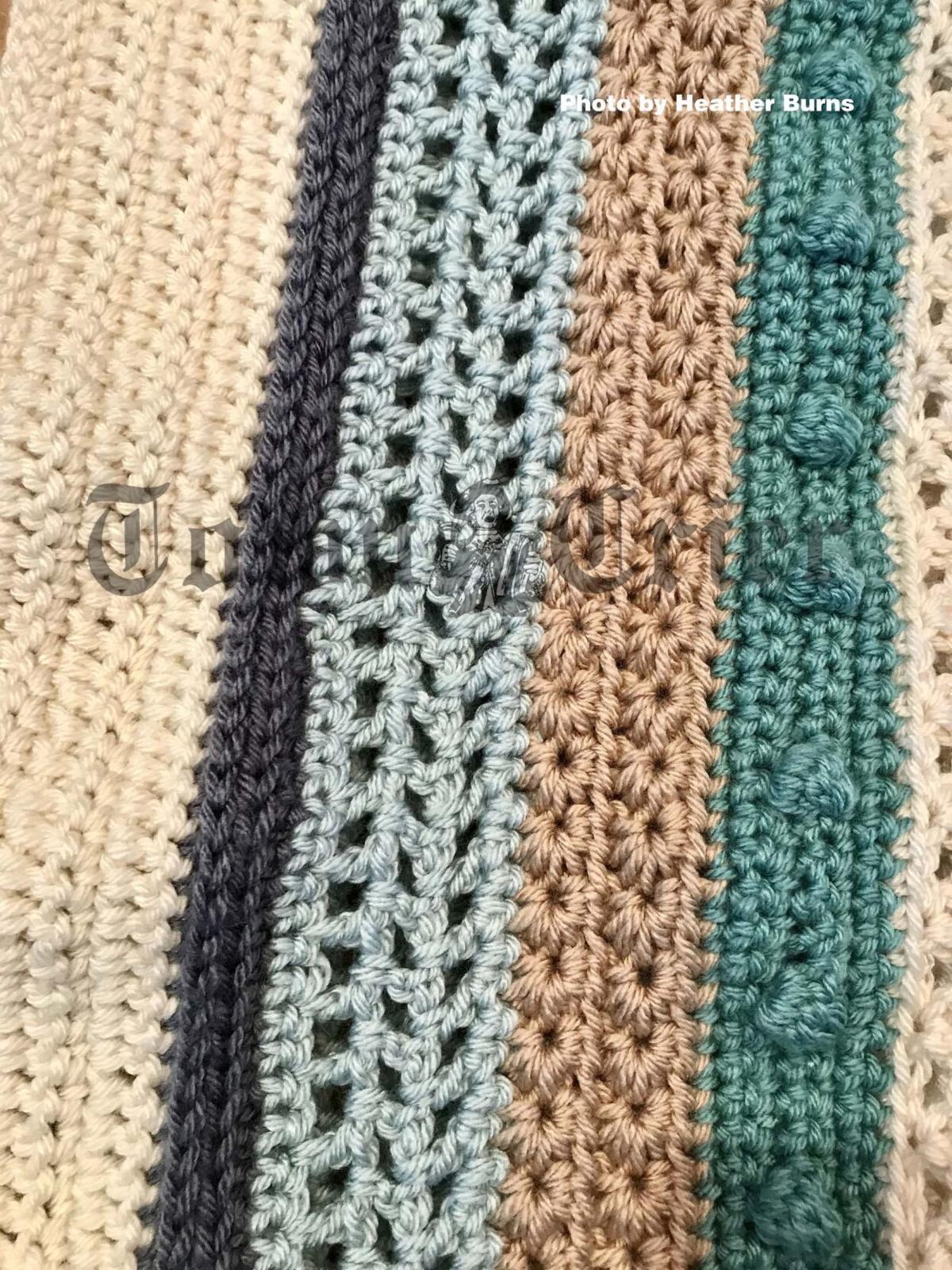 "Crochet afghan with ""sampler"" of patterns"