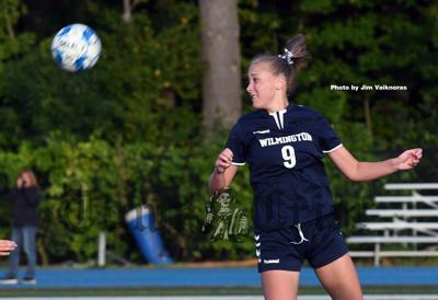 WHS Striker Annie Wingate heads the ball
