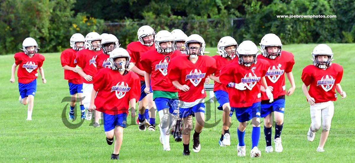 Members of the fifth grade team go for a run before practice