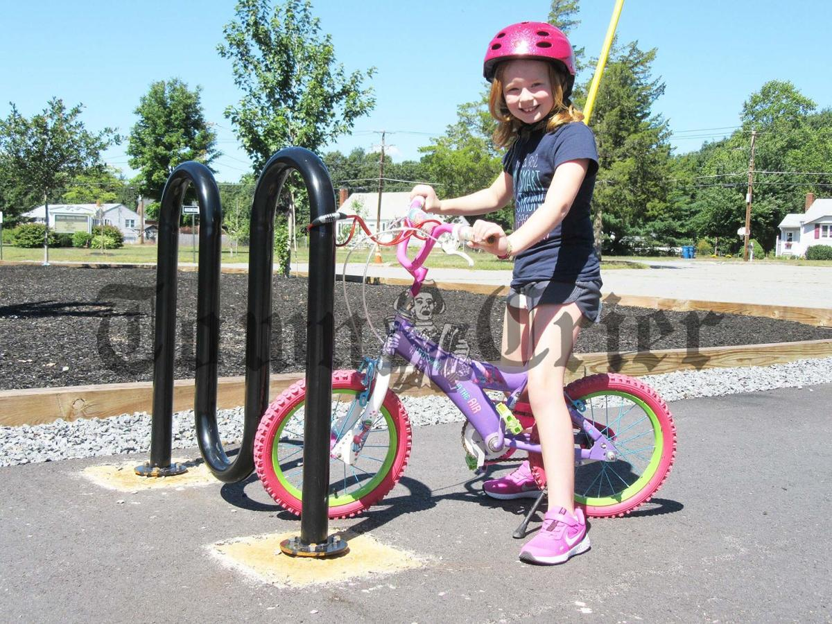 Rising second grader Lydia Seichter with her bicycle