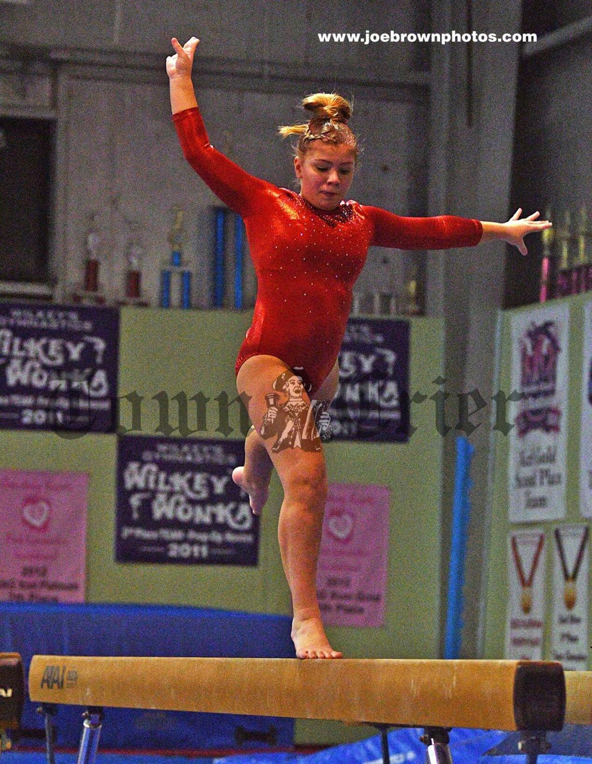 Abby McCarthy works on her routine on the balance beam