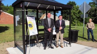 Tewksbury Selectman Mark Kratman and LRTA Administrator Jim Scanlan at the new bus shelter on Livingston Street
