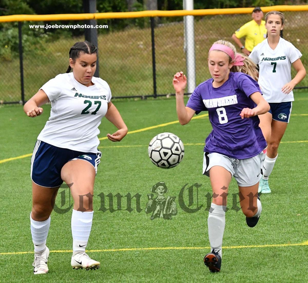 Essex Tech's Lacey Gonzalez and Shawsheen Tech's Kendra Minghella pursue a loose ball