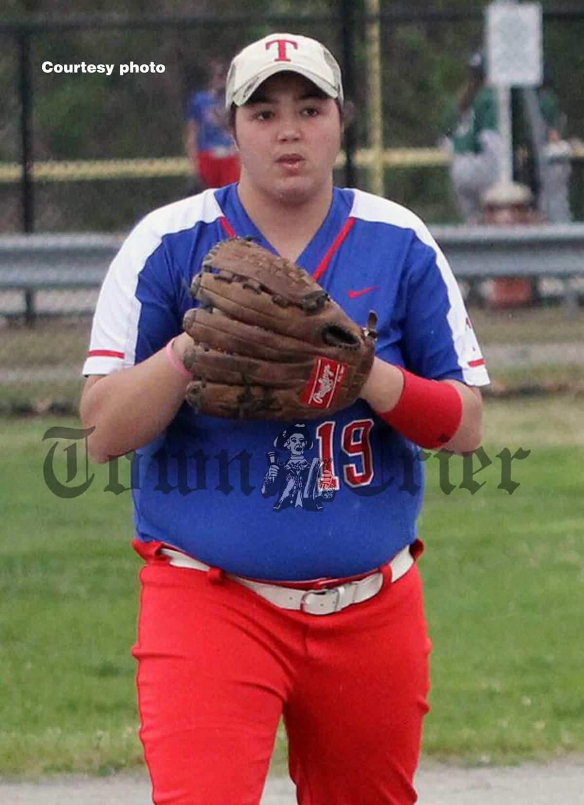 TMHS senior Bella DeRoche at first base