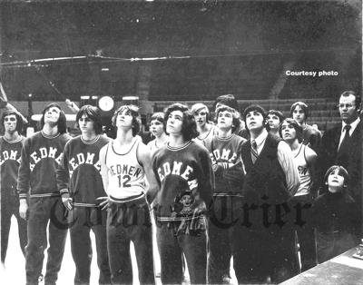 Coach Tony Romano's Redmen look up at the Boston Celtics' championship banners prior to their tourney game