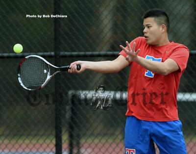 TMHS senior Daryl Quek gets to the ball
