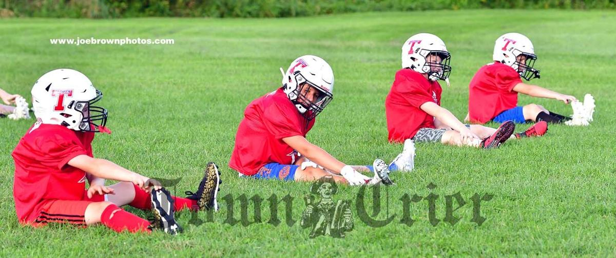 Some of the Tewksbury Youth Football 6th grade team stretch out