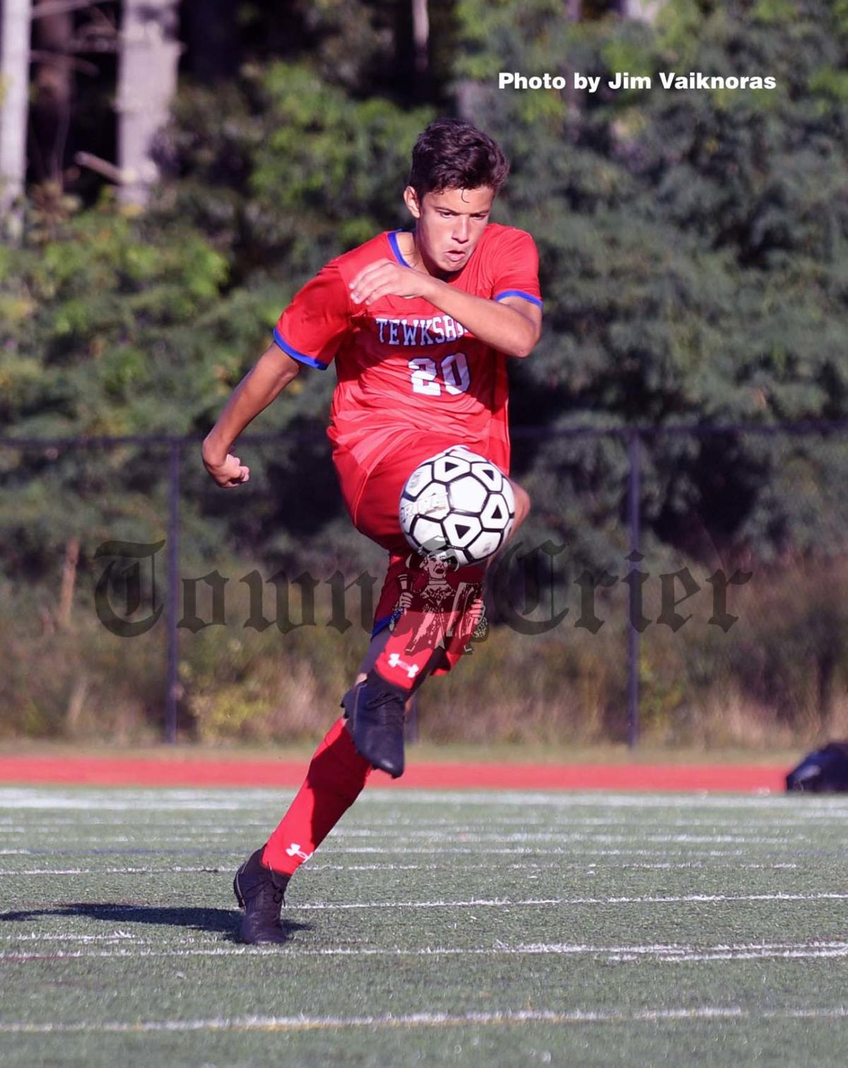 Tewksbury's Justin Rooney boots the ball