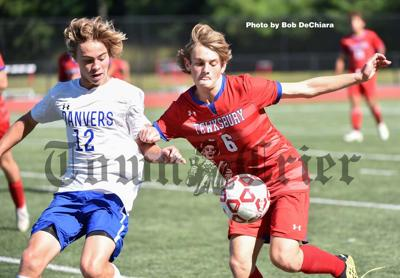 Will Eskenas (right) tries to get control of the ball, while being chased down by Chance Prouty