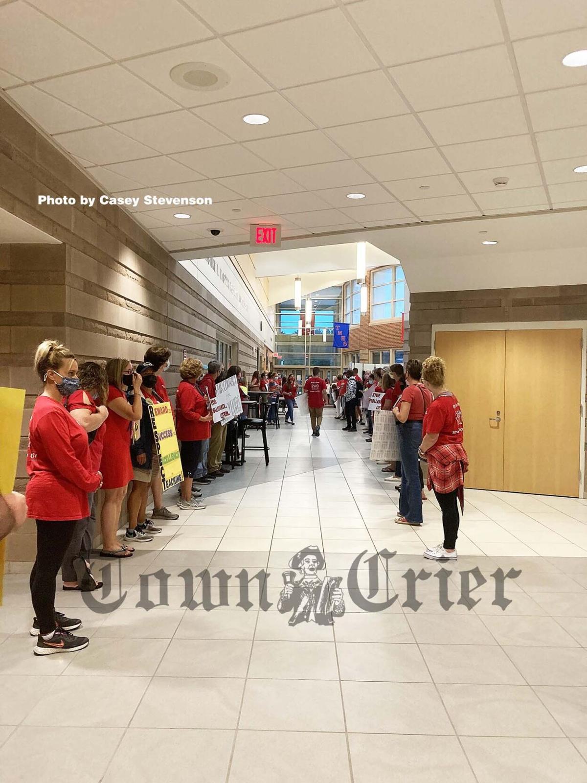 Tewksbury teachers and aides wait outside the auditorium