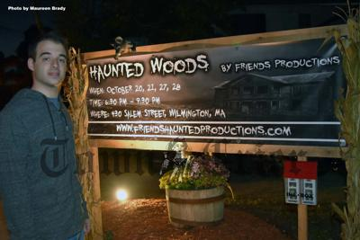 "Steve Valente with sign from ""Haunted Woods"""