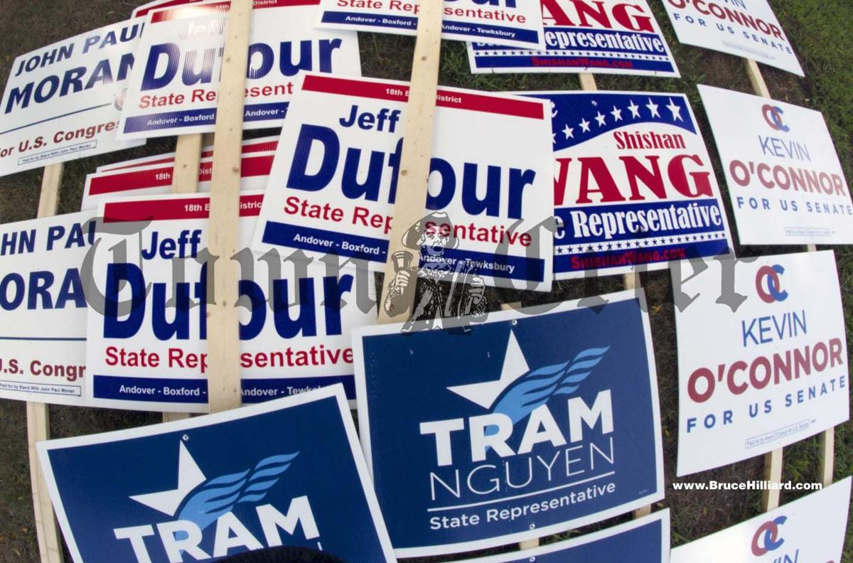 Campaign signs on the lawn at Tewksbury Town Hall