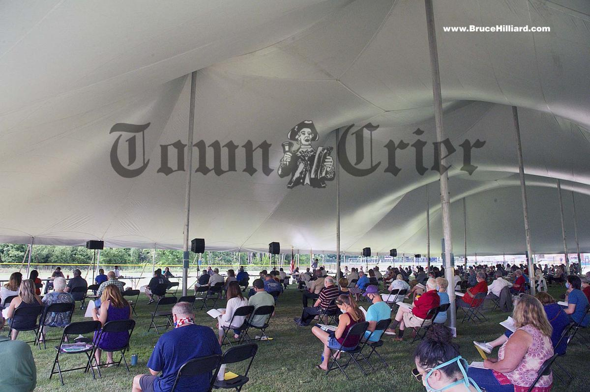 Town Meeting was held outdoors under a large tent