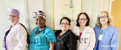Mary-Ellen Cooper (center) has been named the Massachusetts Coalition of Nurse Practitioners 2021 Distinguished Nurse Practitioner