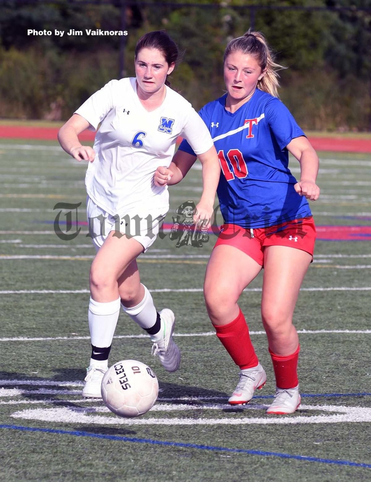 Tewksbury's Alex Fowler fights for the ball