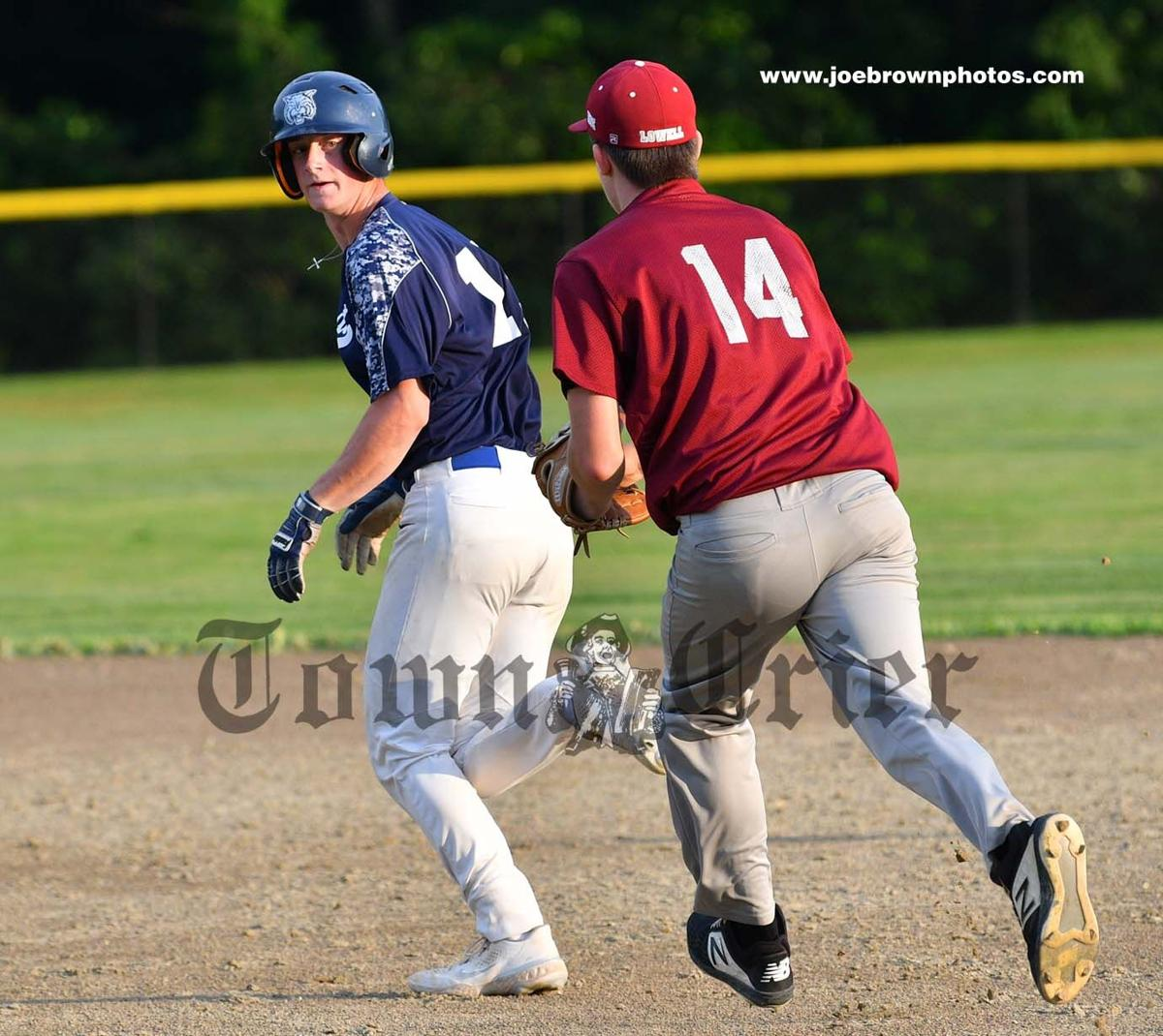 Wilmington's Matt Vinal is chased by Lowell's Jack Soucy