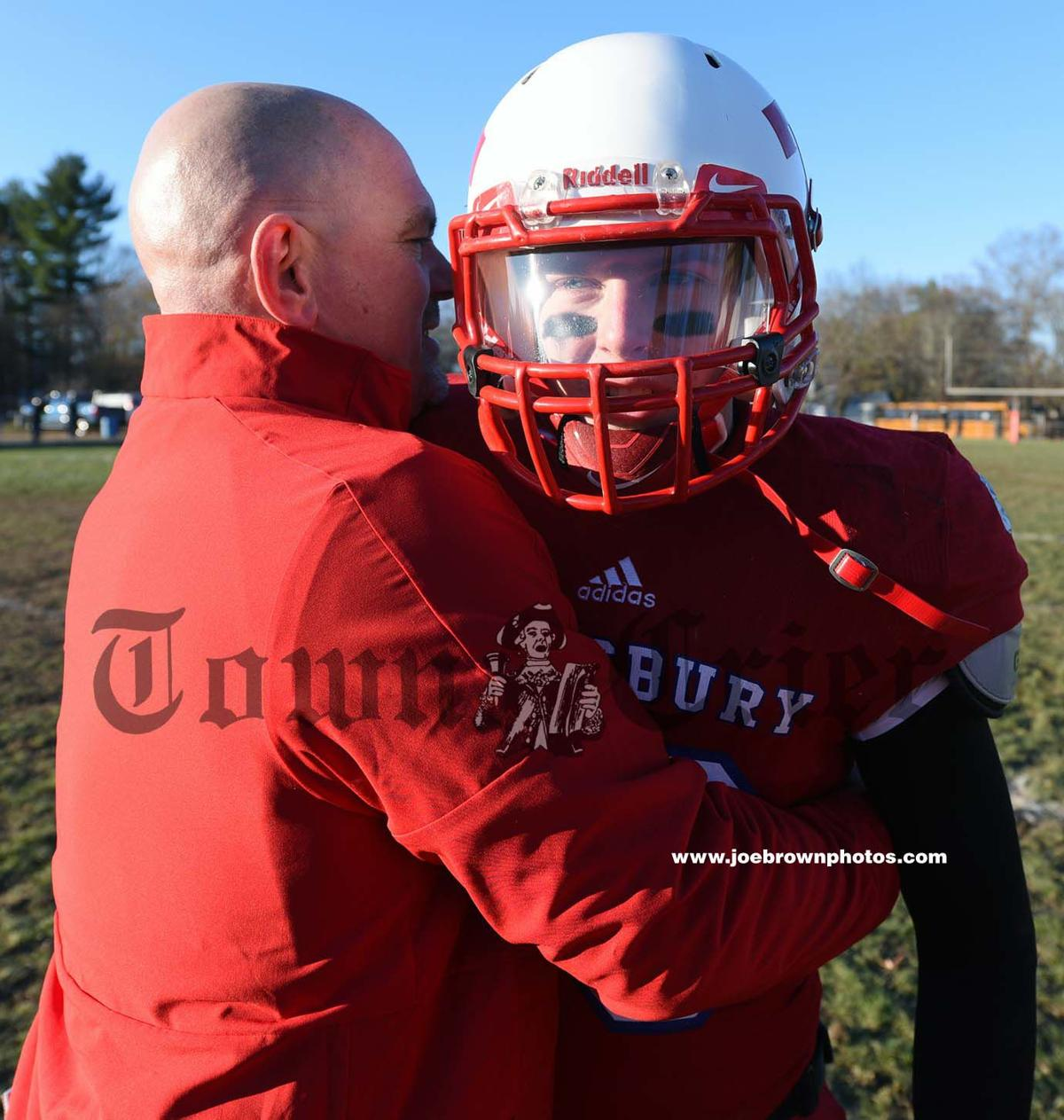 Brian Aylward and junior quarterback Ryne Rametta celebrate