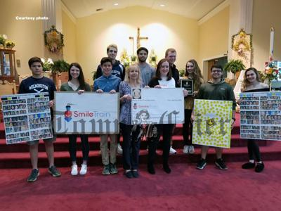 Youth group donates to Smile Train