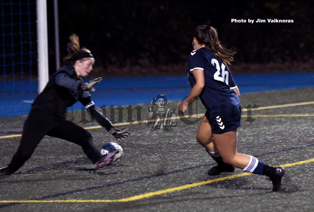 Aly Colantuoni shoots the ball for the goal.