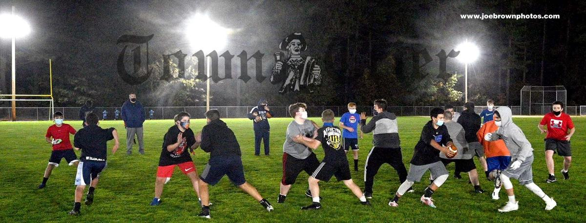 Wilmington Middle School Football team under the lights at the Glen Road Field Complex