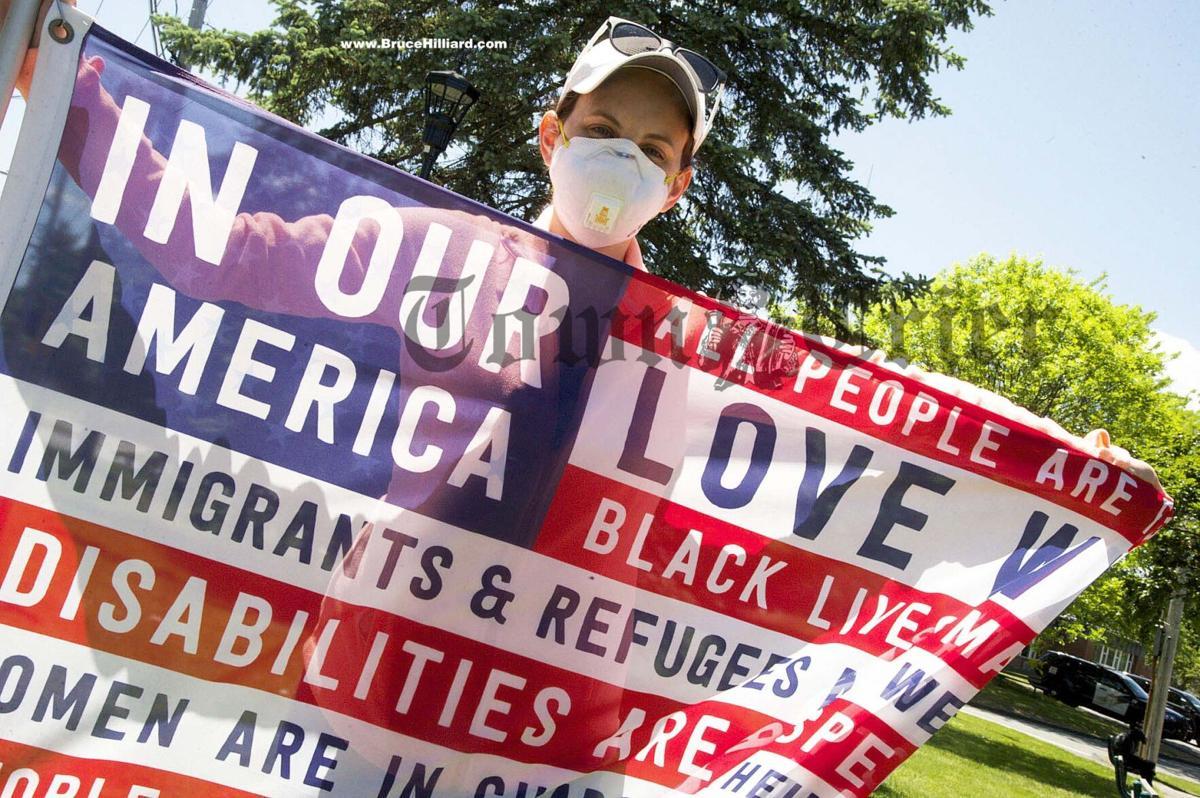 Kristyn Iovanni-Shawghnessy with her flag