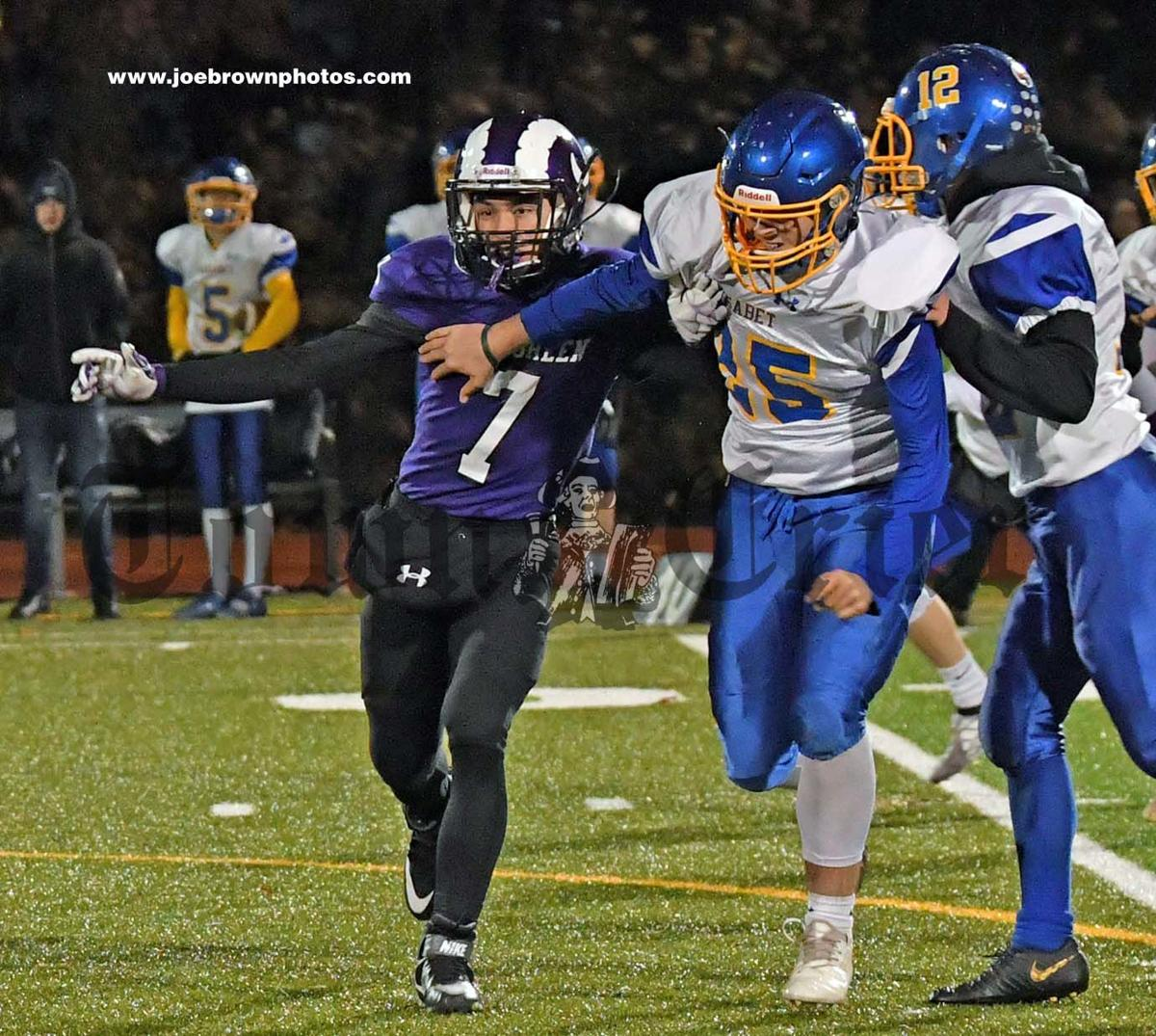 Tewksbury's Anthony D'Ampolo holds back Assabet players