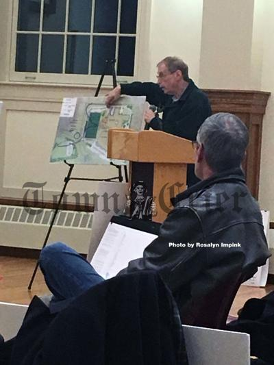 Munro Circle resident Gregg Mann discusses wetland boundaries