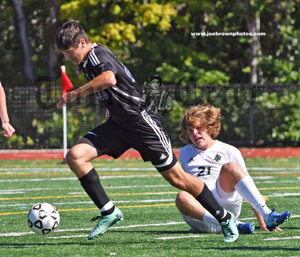 Jared Rizzo of Shawsheen Tech Boys Soccer team controls the ball