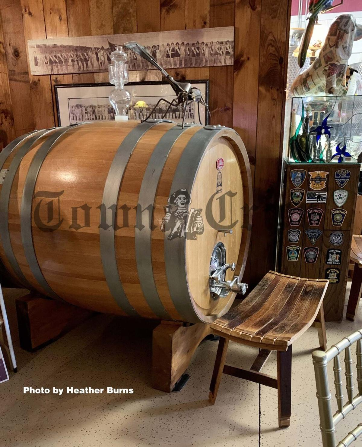 A wood wine barrel inside the First Crush Winery