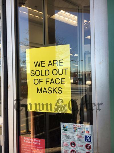 Sign on the door at CVS Stadium Plaza in Tewksbury