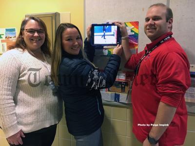 Lisa Bailey, Holly Germain and Jon DiPrima of the Wynn Middle School